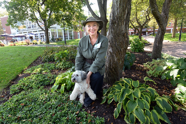 BRYAN EATON/Staff photo. Local artist Edith Heyck, with Taz, is the new Market Landing Park manager.