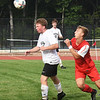 BRYAN EATON/Staff photo. Jack Queenan gets the ball away from a Masco player.