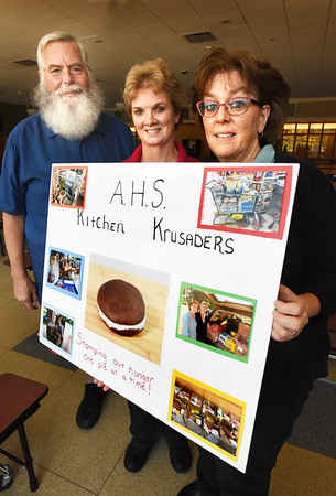 BRYAN EATON/Staff photo. Jeanne Sheehan and her cafeteria crew at Amesbury High School have won this year's Stroke of Genius award for charitable works over the summer by helping to end hunger. From left, Ralph Noon, Sheehan and Karen Clark.