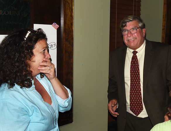 BRYAN EATON/Staff photo. Newburyport mayoral candidate Robert Cronin smiles as his campaign manager Roberta Lenes reacts to their victory.