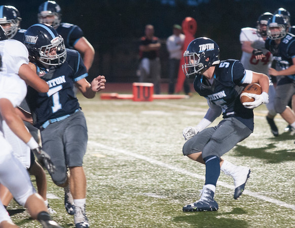 JIM VAIKNORAS/Staff photo Triton's Gabriel Butts makes a move against Marblehead Friday at Triton.