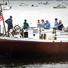 BRYAN EATON/Staff photo. Matt Glenn, captain of The gundalow Piscataqua talks to students from the River Valley Charter School as he steers the vessel down the Merrimack River.