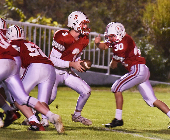 BRYAN EATON/Staff photo. Amesbury quarterback Blake Bennett hands off to Hayden Ayotte.