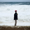 JIM VAIKNORAS/Staff photo Finn Allen of Amesbury checks out the high surf on Salisbury Beach Friday brought on by Tropical Storm Jose. Finn was with his family hoping to see the whales, but the waves drove the leviathans out to sea.