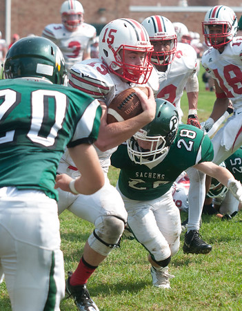 JIM VAIKNORAS/Staff photo Amesbury's Logan Burrill  is hit by Pentucket's #20 Tim Beech and #28 Lucas Ruszkowski at Pentucket high Saturday.
