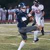 JIM VAIKNORAS/Staff photo Triton's Gunner Gustofson pulls in a pass against Marblehead Friday at Triton.
