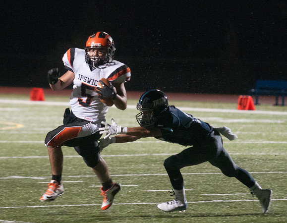 JIM VAIKNORAS/Staff photo Ipswich's Justin Moran breaks off a long run at Triton Friday night.