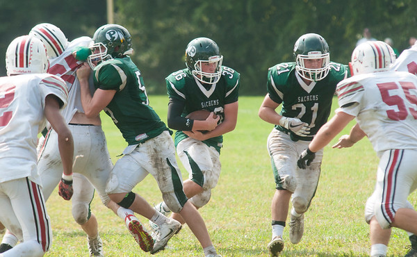 JIM VAIKNORAS/Staff photo Pentucket's Jacob Codairruns behind good blocking against Amesbury at Pentucket high Saturday.