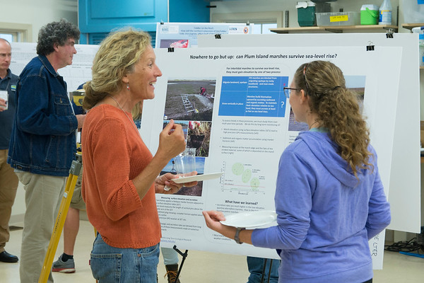JIM VAIKNORAS/Staff photo Dorothy Antczak of the Crane Estate talks with Heather Sweeney from Gordon College at an Open House at the Marshview Field Station on the Newburyport Turnpike in Newbury Tuesday night.