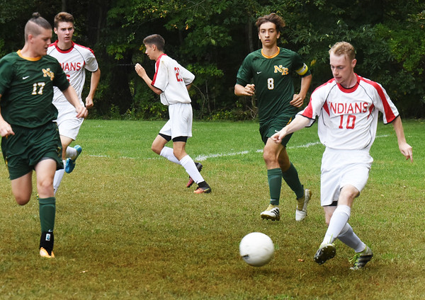 BRYAN EATON/Staff photo. Forward Brian Edmands moves the ball downfield.