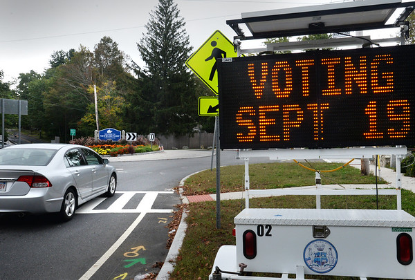 BRYAN EATON/Staff photo. The city of Newburyport has several signs around town to remind citizens to vote today in the mayoral election. Running is incumbent Mayor Donna Holaday, city counselor Robert Cronin and Dr. Hazem Mahmoud.