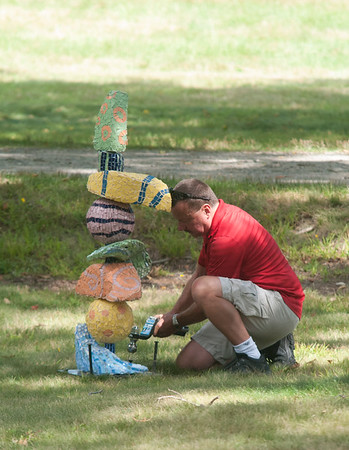 "JIM VAIKNORAS/Staff photo Kevin Doyon installs his wife Cassie's piece ""WhimSea"" at Maudsay in Newburyport."