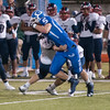 JIM VAIKNORAS/Staff photo Georgetown's Hunter Lane breaks a tackle against Lynn Tech at Georgetown Friday night.