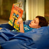 "BRYAN EATON/Staff photo. Shamous Shore, 8, relaxes in a beanbag chair as he reads ""Pete the Cat"" at the Amesbury Elementary School library. After storytime the students checked out books to take home and if they had some extra time started to read them before the period ended."