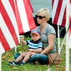 JIM VAIKNORAS/Staff photo Amanda Durking holds her son Travis Maxx Durking at the Field of Honor ceremony on the Bartlet Mall Sunday. Maxx was named for his uncle David Travis Friedrich, who was killed in the line of duty in Iraq in 2003.