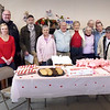 BRYAN EATON/Staff photo. Staff from the Merrimac Council on Aging and some town officials visited residents at the Merri Village housing complex for a question and answer session. Afterwards they had refreshments for a Valentine's Day party.