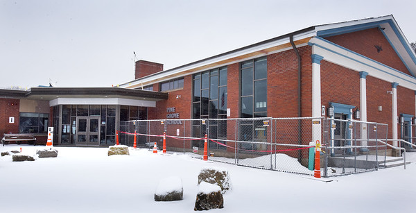 BRYAN EATON/Staff photo. A reconfigured entryway and large windows added to the cafeteria at right are some of the renovations and additions at Rowley's Pine Grove School.
