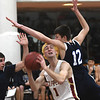 JIM VAIKNORAS/Staff photo Newburyport's Harry Bovee is fouled by Swampscott's Fred Juden at Newburyport High School Monday night.