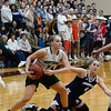 CARL RUSSO/staff photo. With Pentucket fans watching in the background, Pentucket's Angelica Hurley steels the ball from Swampscott's Grace Digrande. Pentucket vs. Swampscott girls basketball in the Division 2 North semifinals. 3/5/2019