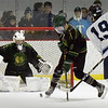 BRYAN EATON/Staff photo. Pentucket goalie Brady McClung makes the save on this shot by Triton's Sammy Rennick.
