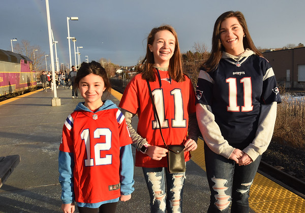 BRYAN EATON/Staff photo. These Salisbury sisters were happy to go see their second Patriots parade in three years, from left, Tenley, 8, Emmerson, 12, and Channing Marengi, 15.