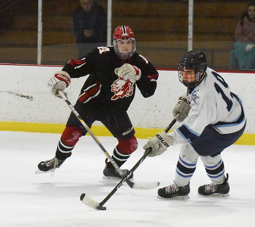 BRYAN EATON/Staff photo. Triton's Sammy Rennick moves the puck past an Amesbury defender.