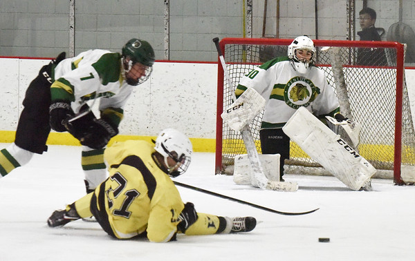 BRYAN EATON/Staff photo. Pentucket's Richie Hardy thwarts a shot by Haverhill's Casey Langley as goalie Brady McClung is at the ready.