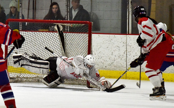 BRYAN EATON/Staff photo. Masco goalie Molly Elmore hits the ice to make a save.
