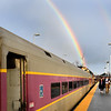 BRYAN EATON/Staff photo. A double rainbow appeared as people caught the Newburyport Commuter Rail to see the Patriots' parade in Boston. One of the trains inbound was reported as standing room only.