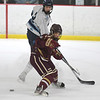 JIM VAIKNORAS/Staff photo Triton's Cael Kohan and  Newburyport's Tucker St. Lawrence race for the puck at the Graf Rink in Newburyport Saturday.