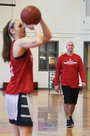 BRYAN EATON/Staff photo. Amesbury High School girls basketball head coach Gregg Dollas with his team at practice.