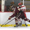 JIM VAIKNORAS/Staff photo Newburyport's Robert Johnston collides with St John's Hunter DiGregorio  during their game at the Graf Rink in Newburyport Friday.