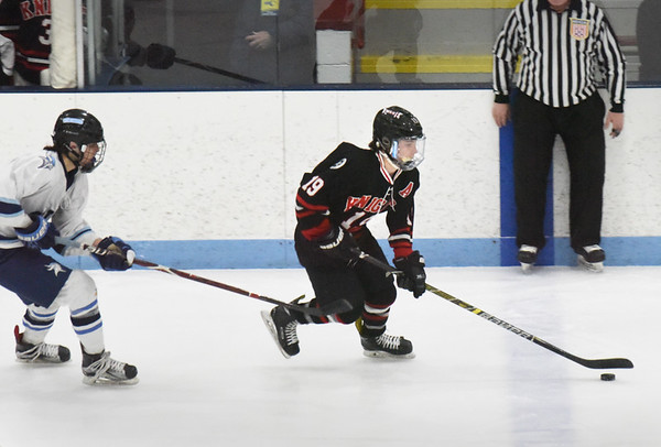 BRYAN EATON/Staff photo. North Andover forward Kyle Hooley moves the puck into Triton ice.