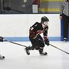 BRYAN EATON/Staff photo. North Andover forward Kyle Hooley moves the puck into Triton ice.