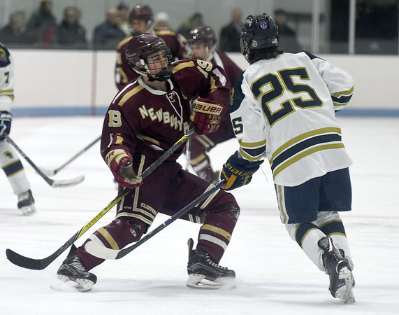 JIM VAIKNORAS/Staff photo Newburyport's Michael Twomey checks  St Mary's Alex Nazarian at Connery Rink in Lynn Wednesday night.