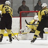 BRYAN EATON/Staff photo. Haverhill goalie Zachary Roughan stops a shot by Pentucket.