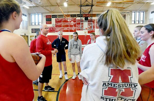 BRYAN EATON/Staff photo. Amesbury High School girls basketball head coach Gregg Dollas with his team at practice.