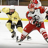 BRYAN EATON/Staff photo. Haverhill's Casey Langley moves in on Amesbury's Ethan Lintner.