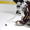 JIM VAIKNORAS/Staff photo Newburyport's Jackson Marshall with a save against Triton at the Graf Rink in Newburyport Saturday.