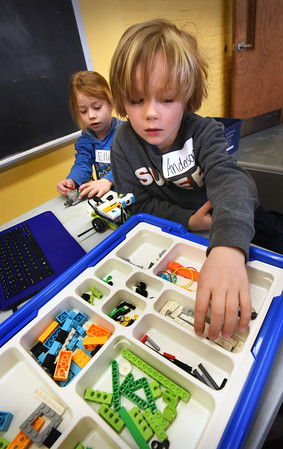 BRYAN EATON/Staff photo. Newburyport Youth Services has many activities this week for school vacation including Lego Robotics and Engineering at the Rec Center. Anderson Teel, 5, grabs a component for his space robot while Ella O'Neil, 5, works on what she calls a helper robot.