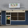BRYAN EATON/Staff photo. The massage parlor on Lafayette Road in Salisbury has a ceast and desist sticker on the door.
