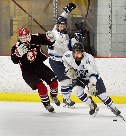 BRYAN EATON/Staff photo. Triton forward Sammy Rennick gets the puck from behind the net.