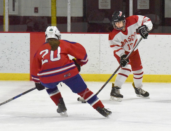 BRYAN EATON/Staff photo. Methuen's Carolyn Curley moves in as Izzy Kirby looks to pass to a teammate.