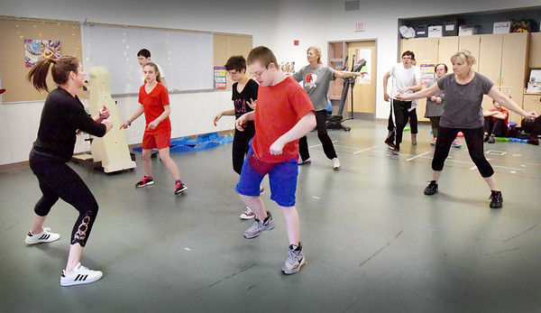 BRYAN EATON/Staff photo. Amesbury High School post-graduates participate in Zumba classes at the school every Thursday. They raised enough money from recycling and coffee sales to buy the classes for themselves.