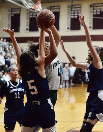 CARL RUSSO/staff photo. Pentucket's Arielle Cleveland drives to the hoop. Pentucket vs. Swampscott girls basketball in the Division 2 North semifinals. 3/5/2019
