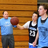 BRYAN EATON/Staff photo. Triton boys basketball head coach Ted Schruender watches his team in practice.