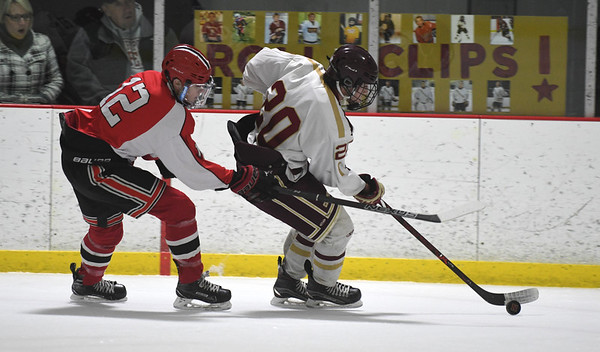 JIM VAIKNORAS/Staff photo Newburyport's Jacob Grossi-Hogg makes a move on Winchester's Colin Van Stry at the Graf Rink in Newburyport Tuesday night.