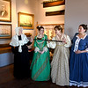 "JIM VAIKNORAS/Staff photo Maureen Daley as Suzannah Graves Shannon, Allegra Larson as Carolyn Graves,  Sally Nutt as Mary Lunt Graves ,and Shannon Mons as  Fannie Brae pose in costume at the Custom House in Newburyport. They will be giving a performance of ""Captains Wives and Daughters""  to members in March."