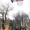 BRYAN EATON/Staff photo. The Kelley School playground at Bartlet Mall has some play equipment and a basketball hoop.