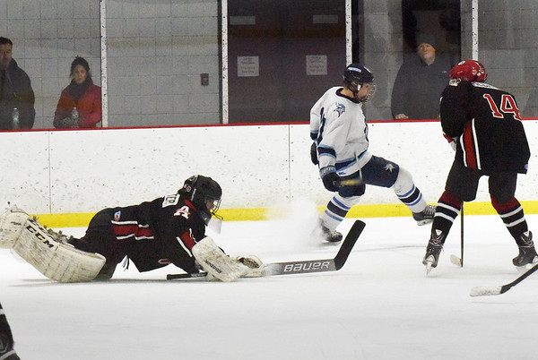 BRYAN EATON/Staff photo. Amesbury goalie Evan Piscitelli makes a diving save on a shot by Triton.